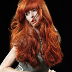 Redhead female model uses Hairdreams Lasebeamer Nano to give her a vibrant style